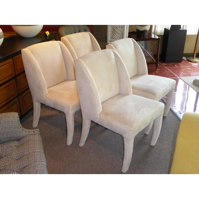 REDUCED FROM $4,800.- This set of four 1980s sculptural dining chairs designed for Directional with original bone ultra...