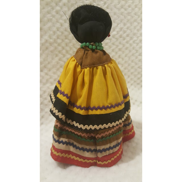 This is a wonderful Native American piece acquired from New Mexico at an estate sale. This is a vividly dressed hand made...