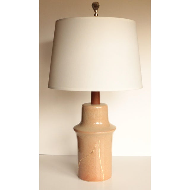 Earthy fawn table lamp by Marshall Studios, designed by Jane and Gordon Martz. Tested and in working order, it measures...