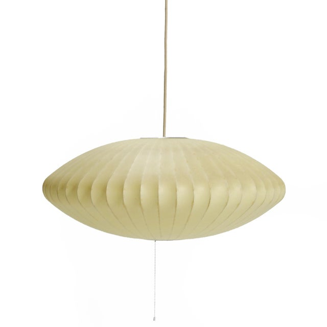 An icon of mid-century modern design, the bubble lamps designed by William Renwick of George Nelson & Assoc for Howard...