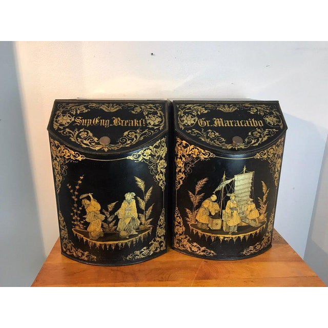 Pair of antique chinoiserie tole floor model tea canisters by Henry Thoemner Each one with a different gilt chinoiserie...