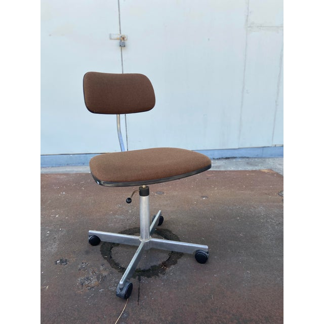 Herman Miller Adjustable Desk Chair. Upholstered in a chocolate brown with black seat back. Very sturdy design.