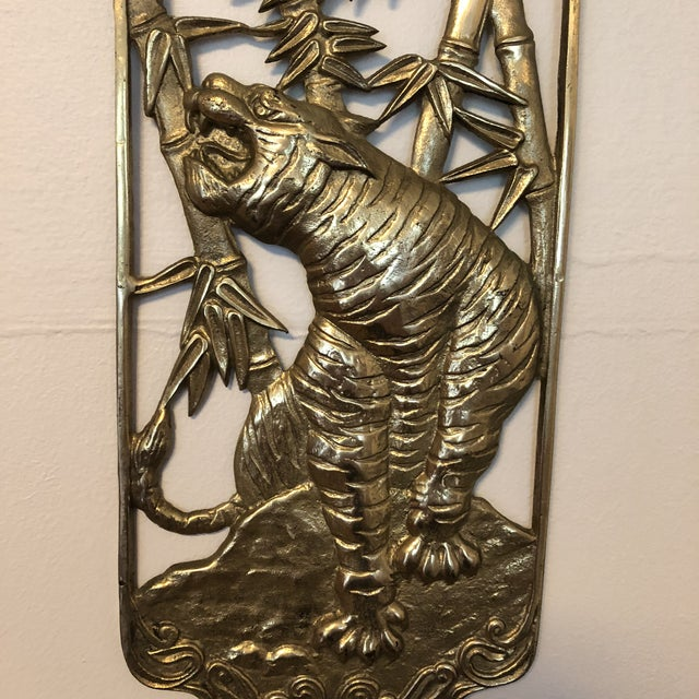 1970s brass Asian wall plaque depicting a tiger. Minor wear and patina consistent with age.