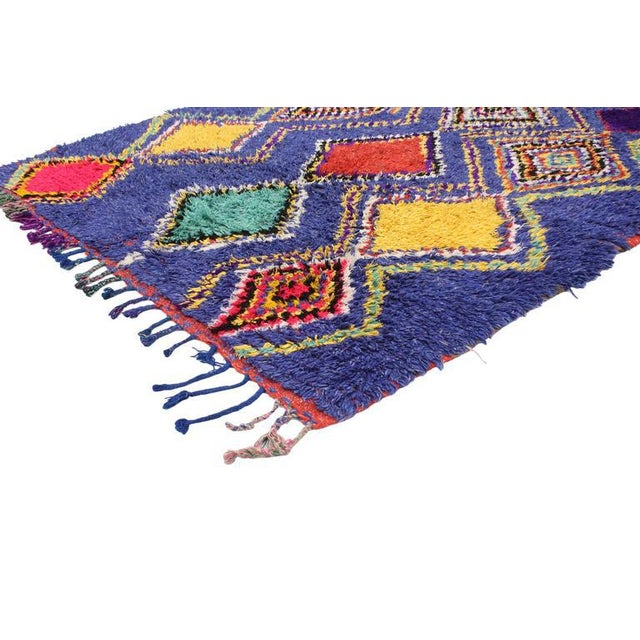 Infuse your space with this boho chic vintage Berber Moroccan rug with tribal design. Saturated in an extraordinary...