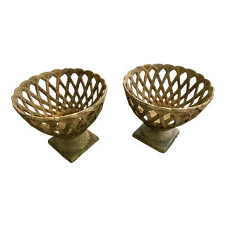 A Pair of French Cast Iron Latticework Fruit Baskets
