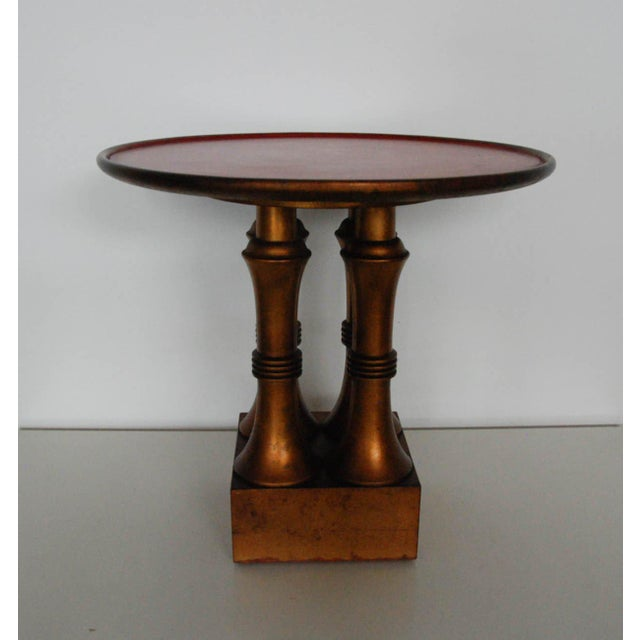 Circa 1950 A fine quiltwood and red lacquer table in the Neo-Egyptian style by Medallion Limited. Impressed Medallion...