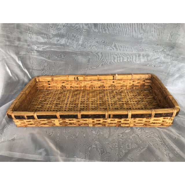 Use this large vintage woven bamboo basket as a serving tray or as a decorative centerpiece on a patio table. The vintage...