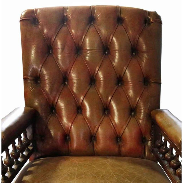 Chesterfield leather and wood armchair on casters. Made in the late 20th century