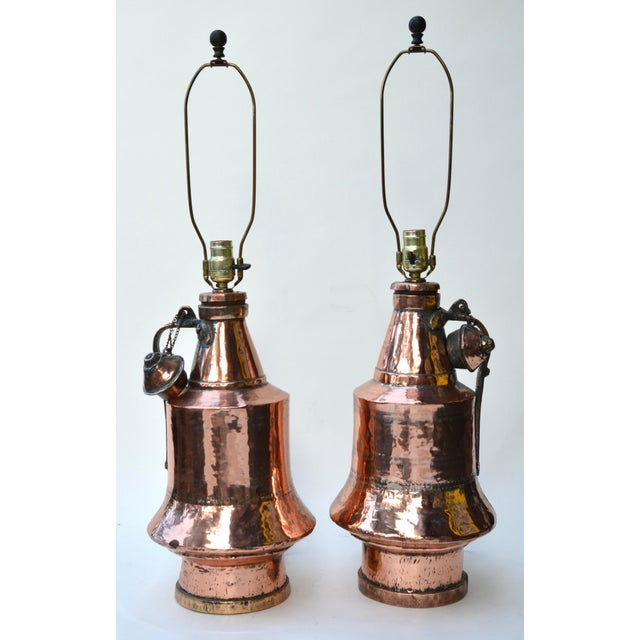 A beautiful pair of Ottoman Anatolian antique hand hammered inscribed copper pitcher vessels made into lamps. Wired and...