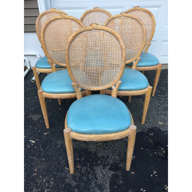 Beautiful set of faux-boos and cane dining chairs. The backrest is cane and base of chair is faux bois. Blue faux aged...