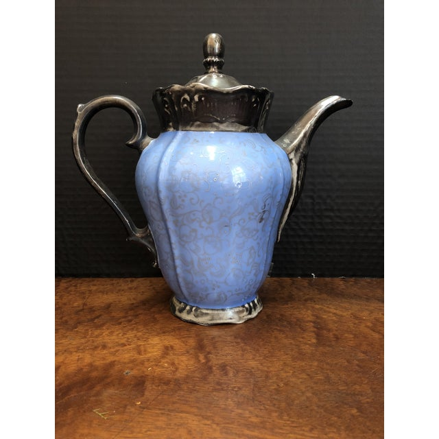 There is a tea pot (with lid), coffee pot (with lid), creamer pitcher, sugar bowl, waste bowl, 5 cup and saucer sets, and...