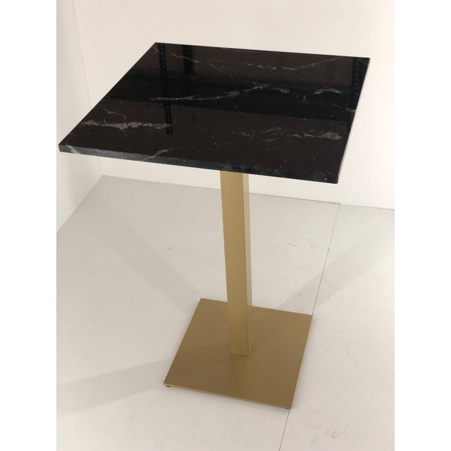 About New bistro high table in gilded wrought iron with black marble top. Additional Options - Colours : black , white,...