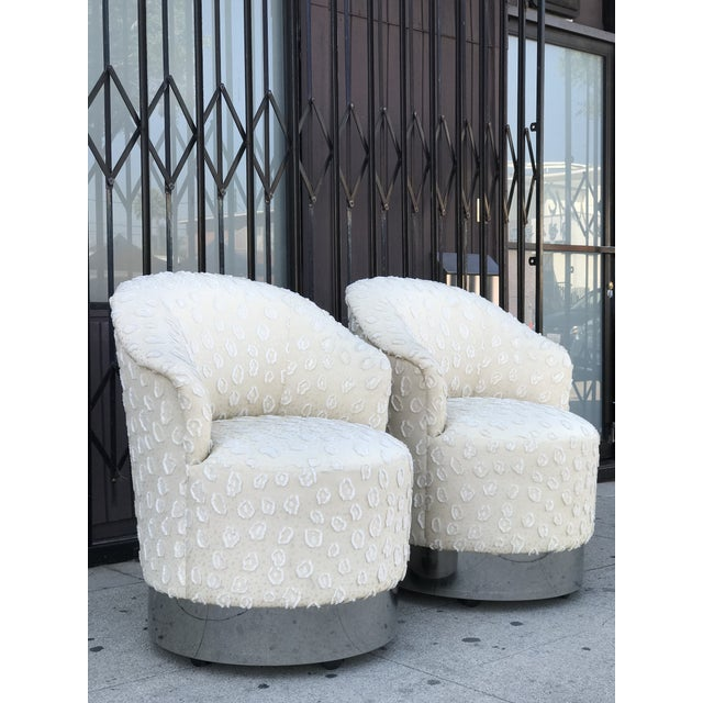 Rolling Chairs with Chrome Base in the Manner of Milo Baughman in its original upholstery. The pair have 4 wheels under...