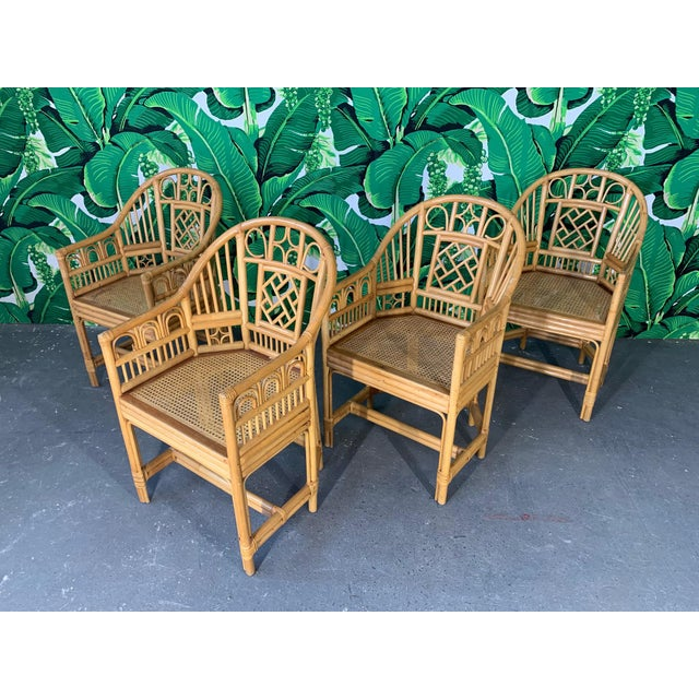 Set of 4 Brighton Pavilion style rattan dining arm chairs feature bamboo construction, cane seats, and chinoiserie style...