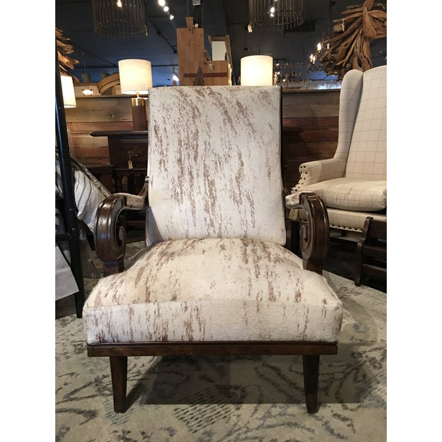 Cosmo Chair made by Paul Robert. It is upholstered in leather/hyde which features beige highlights throughout. Paul Robert...