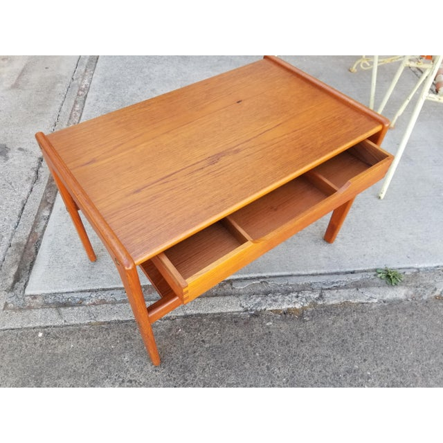 Good craftsmanship and material in this 1970's teak Danish Modern side table. Original finish with beautiful glow to...