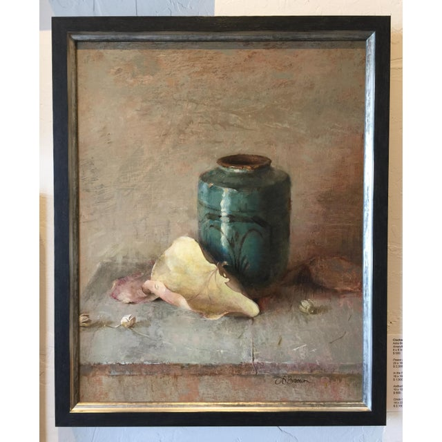 Adra Brown finds beauty in everyday objects from an old wooden table to a chipped teal vase. Dried grape leaves complete...