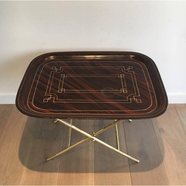 Unusual tray table with a brass base and a lacquer tôle top with gold Greek décor, French, circa 1950 This item is...
