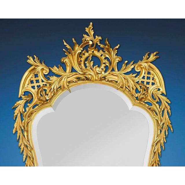 This phenomenal Louis XV style French mirror features an elegant shape and an undulating, intricately carved giltwood...