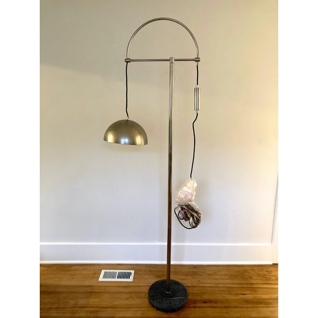Brand new in box Jillian Floor Lamp by Arteriors, this vintage style silver floor lamp can be adjusted with a push of a...