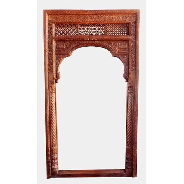 A unique full-length mirror frame made from an old Indian door. Beautifully carved details and one of a kind!