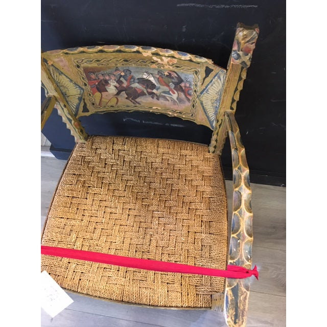 Gorgeous wood carved 19th century Italian arm chair with rope seating; hand carved and painted