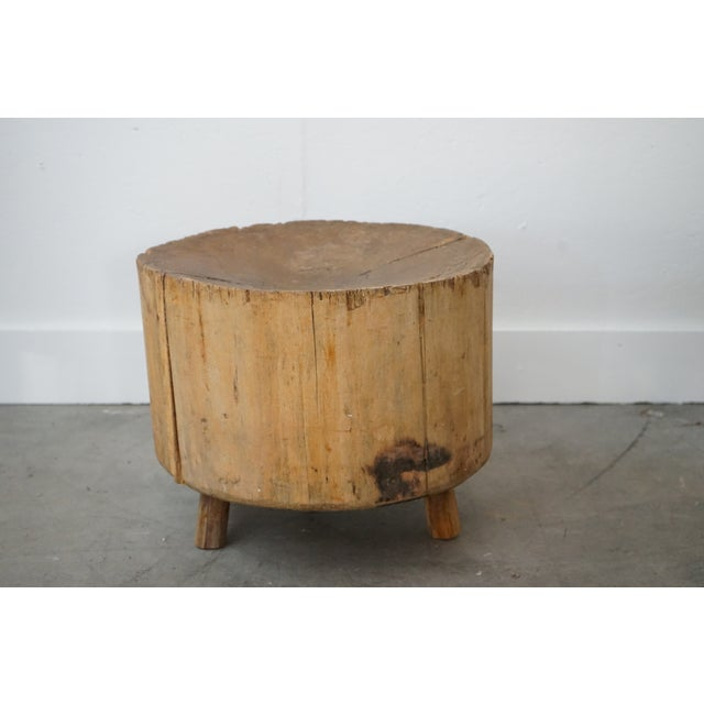 This is a 19th century, French large rough table made from a log with a concave top and a beautiful rustic patina.