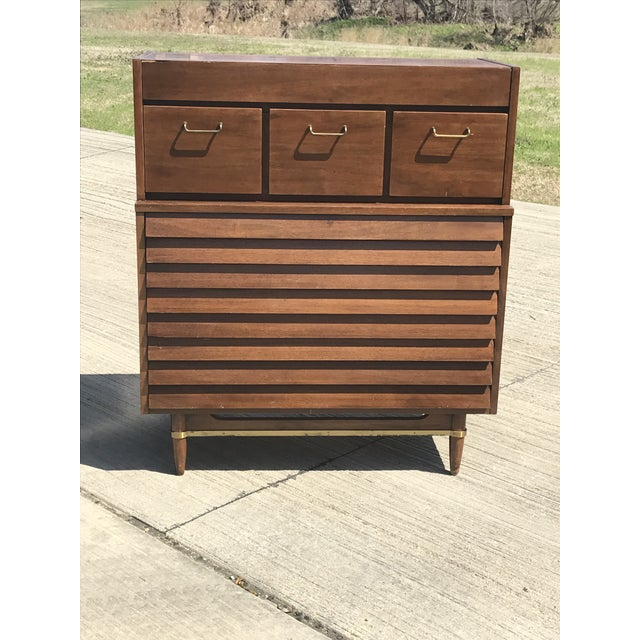 This dresser was designed by Merton Gershun for Martinsville's Dania Collection. It is constructed of walnut and features...