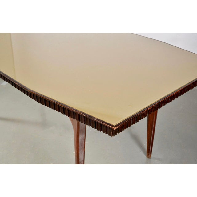 Italian dining table has X-form base with tapered legs, fluted apron and pale green glass top, circa 1960. Unknown maker -...