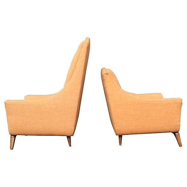 Mid-Century Modern pair of desirable high-back his and hers lounge chairs by Adrian Pearsall, featuring arched tops,...