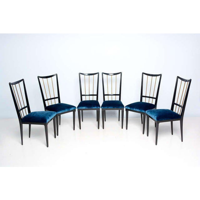 For your consideration a dining set (six chairs and dining table) attributed to Eugenio Escudero. Constructed with...