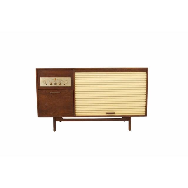 Jens Risom Mid Century Walnut Tambour Door Stereo Console Credenza Credenza measures: 54.25 wide x 21.5 deep x 31.5 high...