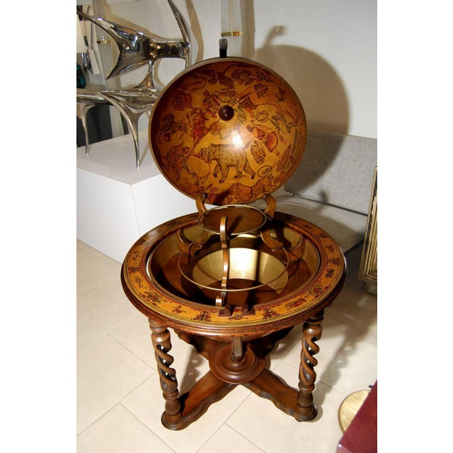 A globe bar in fruitwood with tiered brass and fruit wood interior, Italian 1960's.