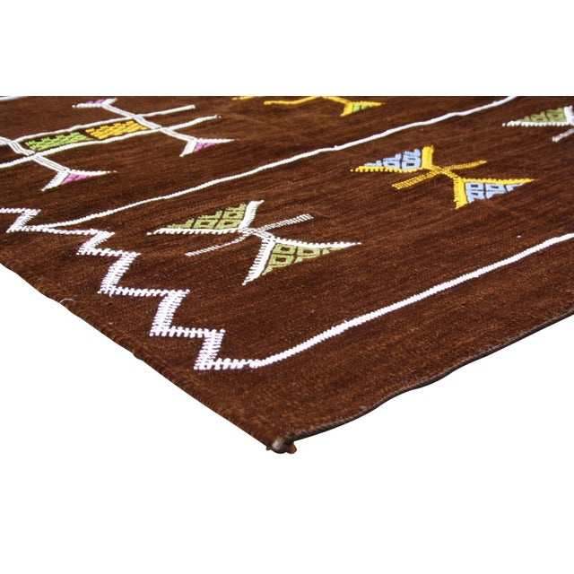 Handwoven Moroccan Berber kilim with geometric shapes. Silky soft texture. Would also make an eye-catching wall hanging or...