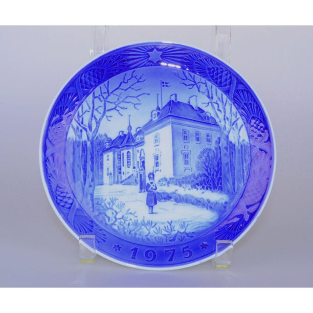 1975 Royal Copenhagen Christmas plate depicting the Queen's Christmas Residence. Maker's mark on underside. Beautiful...