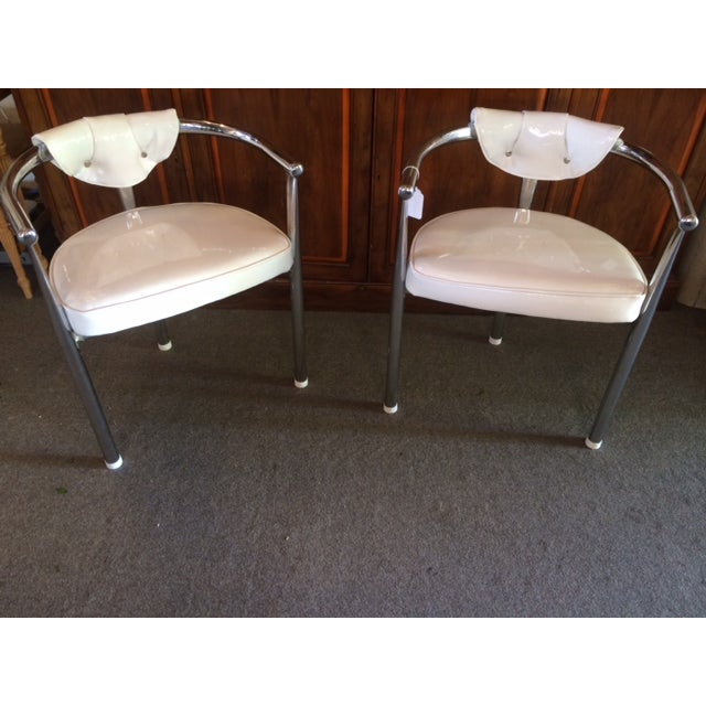 Deceptively comfortable and heavy, this is a stylish set of four vintage chrome chairs newly upholstered in Robert Allen...