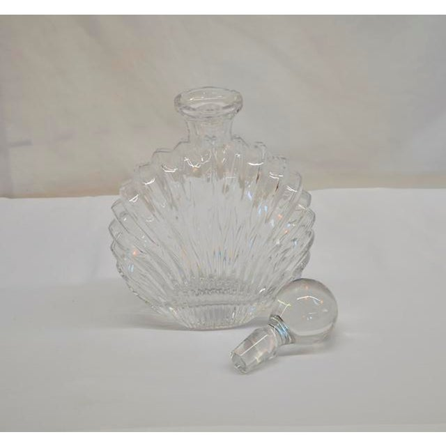 Gorgeous glass decanter with shell design and topper. This one is good looking all the way around!