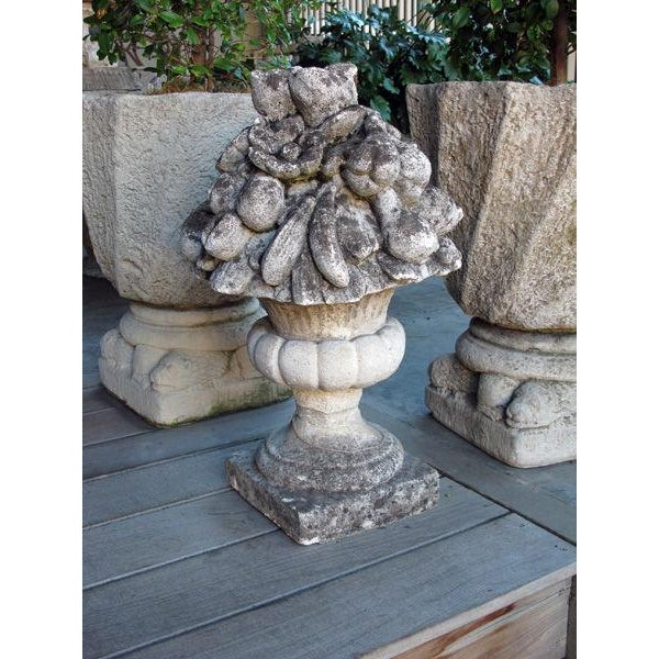 A lush English cast stone floral and fruit-filled garden urn; the splayed campagna urn filled with a luxuriant display of...