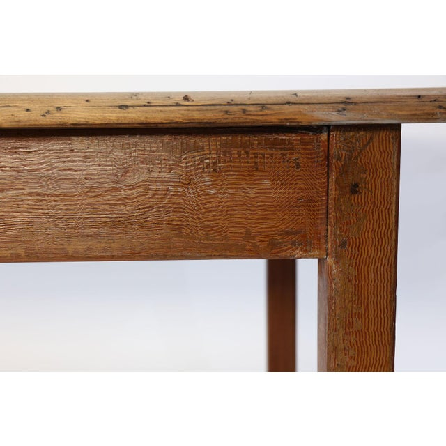 Faux-grain painted French farm table: scrubbed semi-bleached, thick four-plank top raised upon a four-legged trestle base....