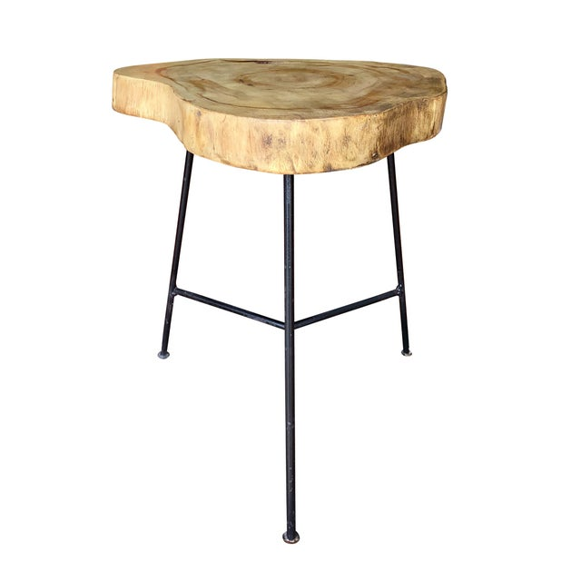 This live edge end table is a great size for a living room or home office. The Pine top displays a drastic grain and is...