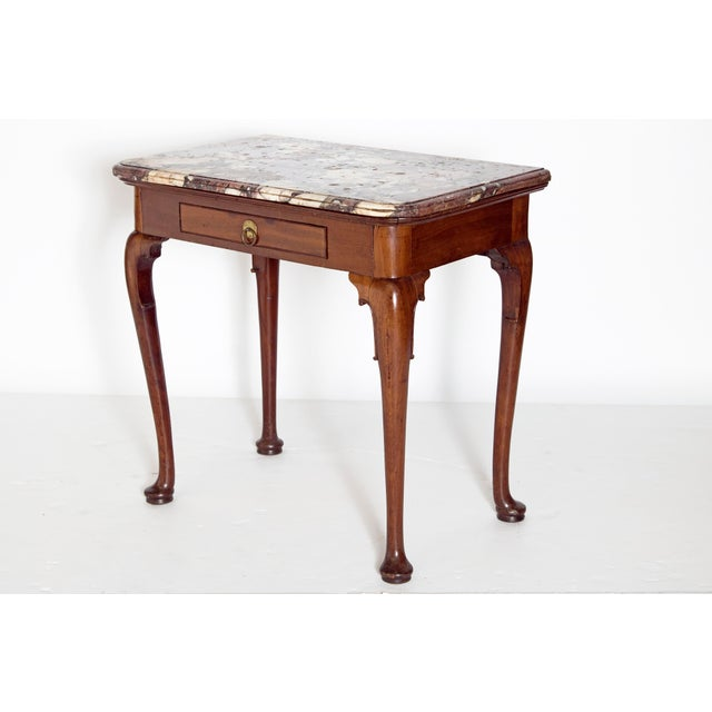 A Queen Anne mahogany side table with one drawer. Raised on cabriole legs with pad feet. Each leg knee has delicately...