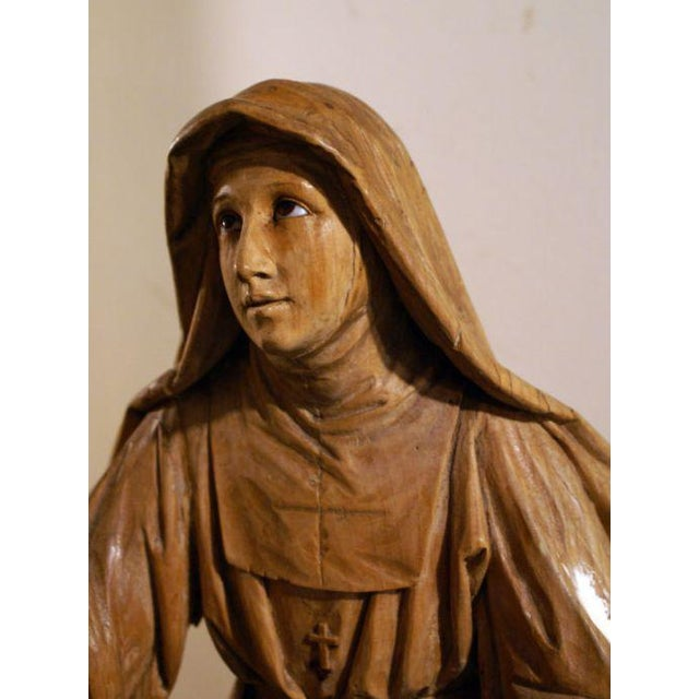 A well carved figure of a praying Nun with glass eyes made in Central Europe during the 19th century. Probably painted and...