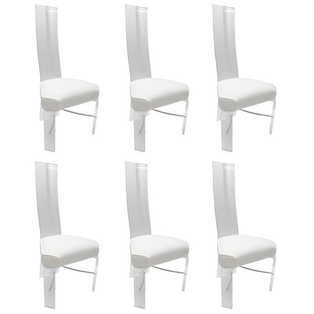 This set of six dining chairs are very much in the style of pieces designed by Charles Hollis Jones and date from the...