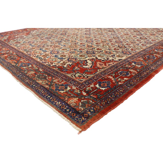Antique Persian Mahal Rug with Victorian Style. This hand knotted wool antique Persian Mahal rug features a lively all-...