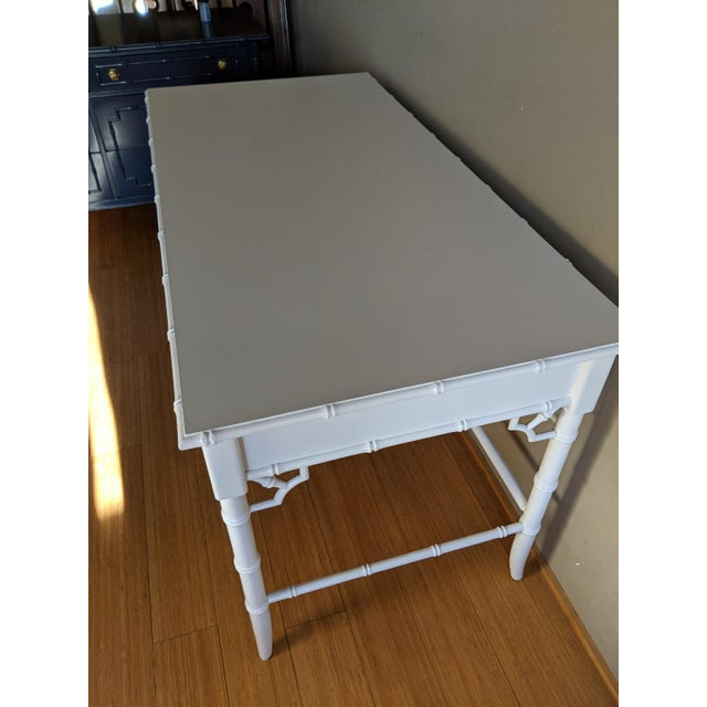 Thomasville Allegro faux bamboo writing desk. Professionally painted in a high gloss white. Durable smooth surface....