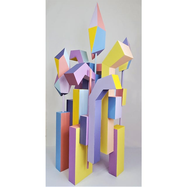 """This is a large sculpture made of plastic and painted (74"""" height, 36"""" width, 29"""" depth). It is an abstract sculpture so..."""