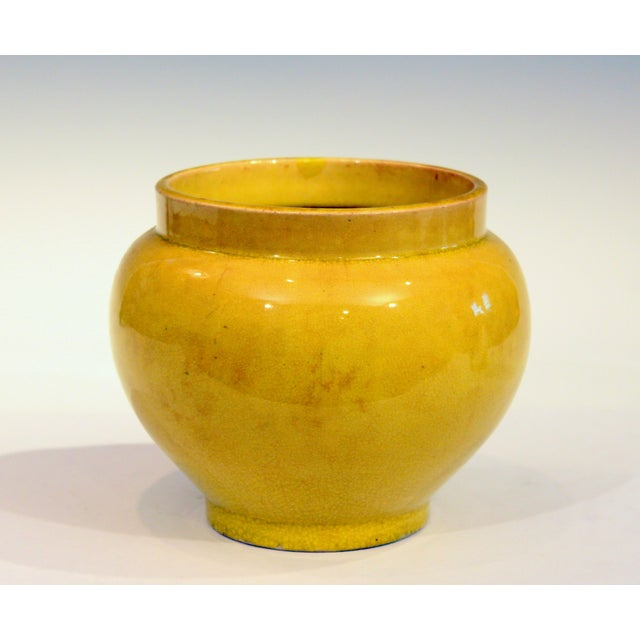 Antique Japanese Awaji pottery vase in globular wide mouthed form with striking yellow monochrome crackle glaze. Circa...