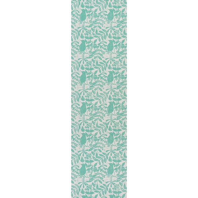 Flora and fauna form a charming and graphic allover botanical pattern, based on a hand block print by English artist Molly...