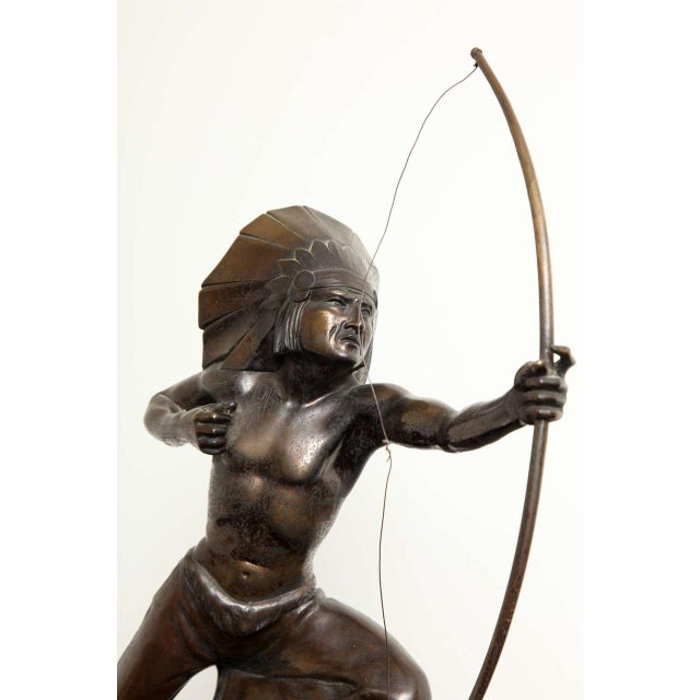 E. Guy, American-Indian Archer, dark patinated bronze on portoro marble base, circa 1940s, H. 15.7 in.