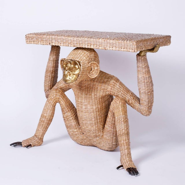 Mario Torres monkey or Chimpanzee console constructed with a metal frame expertly wrapped in wicker or reed. Having a...